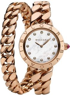 Bvlgari https://www.thesterlingsilver.com/product/invicta-unisex-pro-diver-quartz-watch-with-gold-dial-analogue-display-and-gold-plated-bracelet-14124/