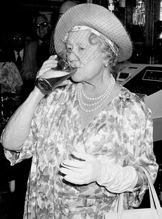 """Queen Elizabeth's beloved Queen Mother wasn't afraid to imbibe — and enjoyed """"steady, rather than excessive"""" consumption of alcohol. Dry Gin Martini, King George Iv, English Wine, Veuve Clicquot, Queen Mother, Past Life, Queen Elizabeth Ii, Wine Drinks, Love Her"""