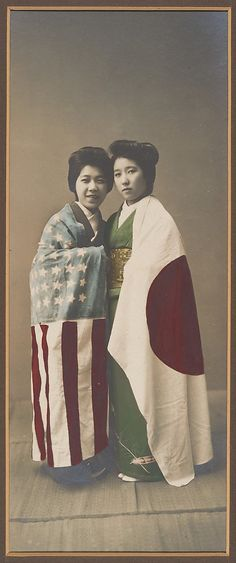 [Japanese Women Cloaked in American and Japanese Flags]