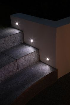 We created subtle lighting on these steps by using UniLED LED deck lights.