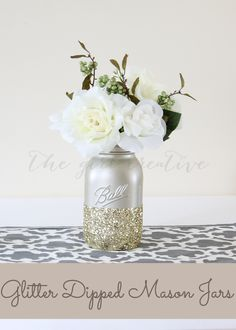 Glitter-dipped-Mason-Jars  Beautiful DIY Wedding Centerpiece Idea. All you need is a little spray paint and lots of glitter!