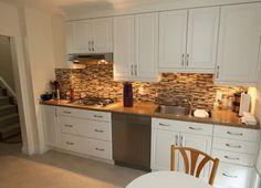 Kitchen Backsplash Designs With White Cabinets glass mosaic backsplash black granite. i like the contrast between