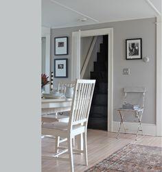 gray walls, white trim, light floors, black stairs