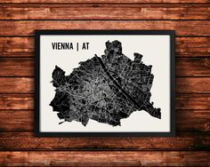 Vienna Austria map art print by Mr. City Printing. Thousands of lines were created to represent almost every street within Viennas limits. To give the poster depth, the streets vary by the width of the road. The silhouette outlines over 150 square miles of Vienna, with the Danube river running distinctly through middle. A unique modern piece that I hope any traveler or resident of Vienna will love. Each print is signed on the back. Framing is available for an additional cost.  • 50+ Cities…