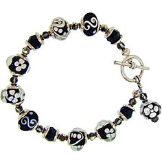 @Overstock - This pretty, handmade glass bead bracelet will stand out on any wrist with its beautiful black and white glass beads and polished silvertone finish. It contains a toggle clasp to ensure easy fastening and is made from high-quality pewter.http://www.overstock.com/Main-Street-Revolution/Misha-Curtis-Silvertone-Black-and-White-Glass-Bead-Bracelet/6340474/product.html?CID=214117 $31.99