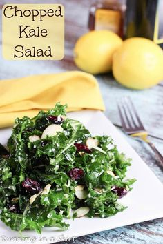 Massaged Chopped Kale Salad with Cranberries.  Served with olive oil, vinegar, honey and lemon homemade dressing. Toasted almonds! / Running in a Skirt