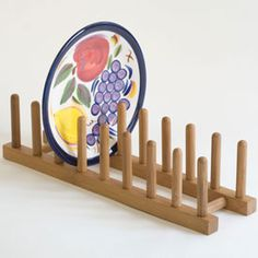 Plate storage -- Bamboo Wood Plate Storage Rack.  This handy kitchen organizer is great for plate storage and can be utilized on countertops or in cabinets.