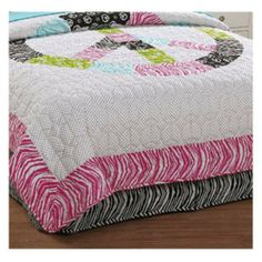 Peace Sign Zebra Queen Dustruffle by Pem America. $57.99. Come home to a room that allows you to relax and enjoy the peace and quiet! Create a room that you will absolutely love! This patch worked comforter allows you to express yourself through its many different patterns. Electric greens, pinks and blues play well with the small black poke-a-dot based pattern. Hot pink zebra stripes and peace signs will have your room standing out and establishing style throughout your bedr...