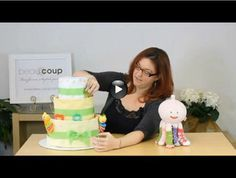 How to build a diaper cake video - they make great baby shower presents!
