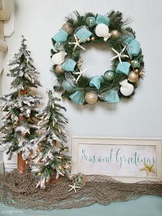 seas and greetings coastal christmas wreath tour this beautiful foyer ready for a very merry nautical noel kirklandschristmasland