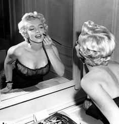 "Marilyn Monroe in a New York Apartment getting made-up for her balcony scene in ""The Seven Year Itch,"" 1954."
