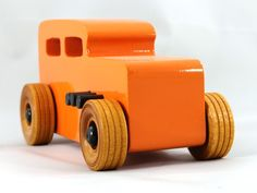 Handmade Wooden Toy Car Hot Rod 1932 Ford Sedan Hot Rod Freaky Ford Orange BlackItem detailsHandmade itemMaterialsSolid MDF Body, Birch Hardwood Axles, Birch Hardwood Wheels, Non-Toxic Acrylic Paint, Non-Toxic Wood GlueA handmade wooden toy car for adults or children three years old and older, sturdy, durable, and made to withstand a little boy's play. With a bit of care, they should still be around for the next generation.I made the original set of Hot Rod Freaky Fords for my grandson Odin…