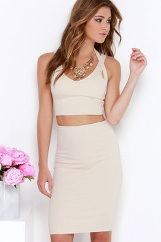 "Why hunt for two matching pieces, when the Piece Together Beige Two-Piece Dress does all the work for you?! Medium-weight stretch knit creates a sleek finish across tank straps and second halter strap, all atop the darted cropped bodice. Complete this sexy look with the bodycon pencil skirt. Hidden back zipper. Small top measures 14.5"" long. Small bottom measures 22"" long."