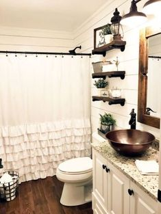 love this shower curtain and rod, with floating shelves above the toilet, wood framed mirror, bowl sink, lights! YES!