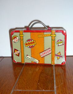 Vintage Toy Tin Lithograph Toy Bank Suitcase Toy Travel Stickers Toy Collectible…