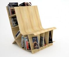 "Minimalist bookcase that playfully curves and becomes a seat is a creative design responding to the emergence of multifunctional space in urban life today. Noted as one of ""10 must sees"" at Toronto Interior Design Show 2009."