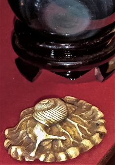 Stag antler Netsuke of a snail on a lotus leaf