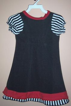 How to make a kid dress out of an adult t shirt. Wish I knew how to sew!