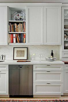 Like the clean look. The cabinet door can have a bit more detail. Love the marble backsplash!