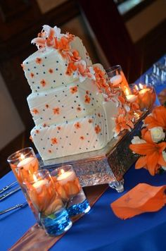 royal blue and orange wedding | ... bride s cake with orange and blue accents in their wedding reception
