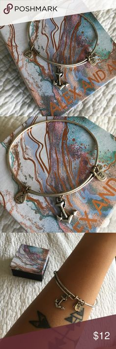 Alex and Ani anchor It has been worn so there's some discoloration in the silver, which only makes it more rustic!😉 Alex And Ani Jewelry Bracelets