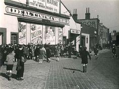 Children queuing outside the Ideal Cinema in King Street, Poplar, c. 1935. www.bkduncan.com