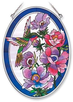 Amia Hand Painted Glass Suncatcher with Floral Hummingbird Design, 5-1/4-Inch by 7-Inch Oval by Amia. $19.00. Includes chain. Comes boxed, makes for a great gift. Handpainted glass. Amia glass is a top selling line of handpainted glass decor. Known for tying in rich colors and excellent designs, Amia has a full line of handpainted glass pieces to satisfy your decor needs. Items in the line range from suncatchers, window decor panels, vases, votives and much more.