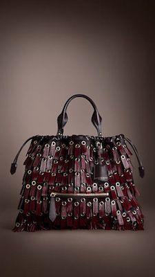 I wouldn't kick this out of bed. Fringed Eyelet Calfskin Drawcord Bag, Burberry.