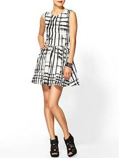 Try out spring's black/white combo with this flirty skirt dress!Crom Dress