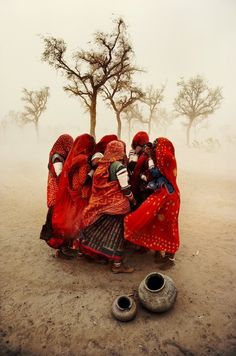 Women shielding themselves from a dust storm. Rajasthan, India, 1983. By Steve McCurry.