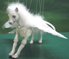 Marionette Puppets. I saw these people at a ren fair in Texas and have been a fan for years.