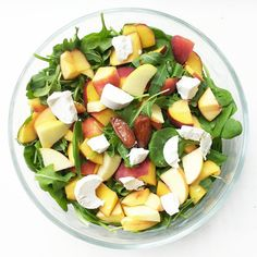 """""""One big spinach salad with arugula, peach, apple, goat cheese, dates and my dads (home grown) honey as salad dressing! So sweet and delicious!"""""""