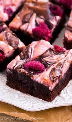 Ultra fudgy homemade brownies swirled with creamy raspberry cheesecake and dotted with fresh raspberries. So good, they're hard to share!