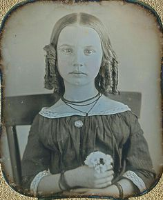 Oh, those blue eyes! She is so intense, I luv it. It appears they had woven friendship bracelets even in the 1840s.