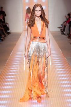 Versace Spring 2013/Milan:  Watery tie-dye-like prints were done up in fringe siren dresses with a glamorous bohemia. So far, it was the sexiest moment on the runways.    Read more: Milan Fashion Week Spring 2013 Runway Looks -   Best Spring 2013 Runway Fashion - Harper's BAZAAR