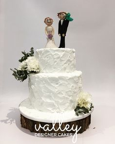 A buttercream beauty with handcrafted and personalised figurines. Cake was white choc Raspberry mud.