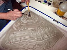Suminagashi...the process of floating ink for printmaking & the Japanese form of marbelizing. via Wildman designs