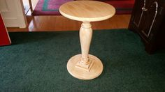 Red wood pedestal table