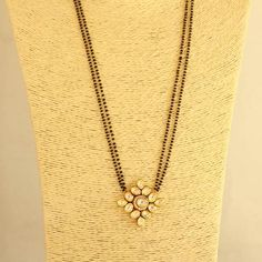 Kundan Designer Pendant has 30 inches 2 line long Mangalsutra attached. Gold Jewelry Simple, Gold Rings Jewelry, Hand Jewelry, Jewelery, Diamond Mangalsutra, Gold Mangalsutra Designs, Gold Chain Design, Gold Jewellery Design, Pearl Necklace Designs