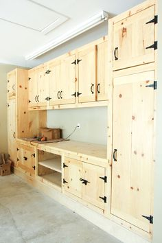 As much as I like steel cabinets, these wooden ones are great. They make garage storage look good not sterile and utilitarian. #garagestorage #storagecabinets