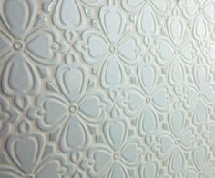 Using the same tone in two different finishes is a subtle way to add interest to your backplash. Shown here is our Brocade pattern in Satin Silver with glossy Light Gray accents | juleptile.com