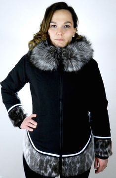 Mid-length form fitting parka with an amautik style sealskin hem that creates a time-less, feminine look. Features contrasting sealskin hem, hood with fox fur t Inuit Clothing, Aboriginal Clothing, Fur Fashion, Fashion Tips, Fashion Design, Fur Trim Coat, Native American Clothing, Victoria Fashion, Parka Style