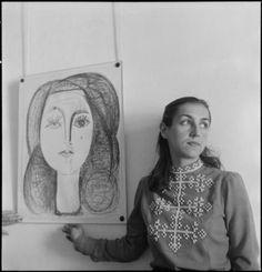 Francoise Gilot next to her portrait by Pablo Picasso