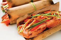 Asian Salmon with Vegetables- grilling with cedar papers is easy and makes  a meal taste delicious. Find them on our website www.fireandflavor.com