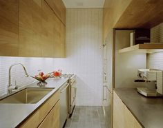 Galley kitchen in a lofted studio apartment