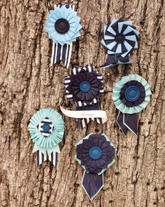 I like this alternative to traditional boutonnieres Pal and hatmaker Tricia Roush crafted colorful cockades, which the groomsmen wore as boutonnieres (item 20)