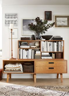 a midcentury furniture piece acts as storage for the entryway   relaxed ranch house tour on coco kelley