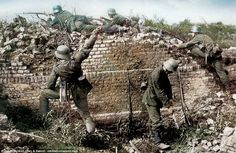 German shock troops advancing, after breaking through the barbed wire...