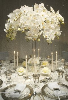 Orchid filled tablescape using Arte Italica's Vetro Silver dinnerware.