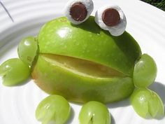 "Apple Frogs--A CUTE SNACK IDEA! I'd forgotten about this, but we made these at an educational ""Cousin Camp"" for my nieces. This would be a fun classroom project after visiting an orchard or vineyard.We used cream cheese for the eyes, also embellished with blue borage flowers from the garden."